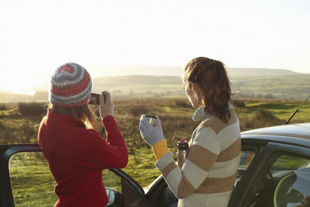 Women admiring landscape from car